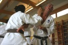 Jo Reyes and Mark Searson practice kumite drills.