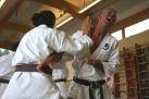 Jo Reyes and Mark Searson practice kumite drills.