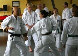 2009 June - Sugasawa Sensei demonstrates technique on Jo Reyes.