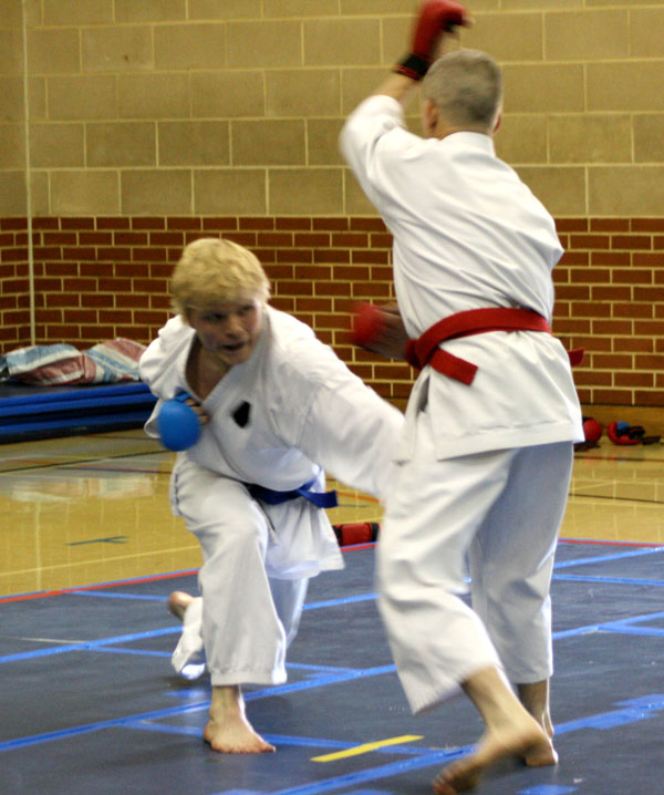 2009 Shikukai Championships Swindon. Senior mens kumite. Chris Mortimer attempts to get a score in on Andy Cambridge.