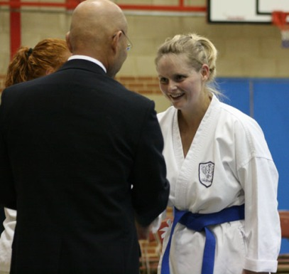2009 Shikukai Championships Swindon. Teresa Allen of Chelmsford is congratulated for her 2nd place in the ladies junior grade kumite by Sugasawa Sensei.