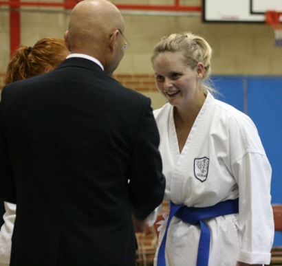 2009 Shikukai Championships Swindon. Teresa Allen of Chelmsford is congratulated for her 2nd place in the ladies junior grade kumite by Sugasawa Sensei.