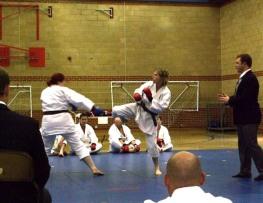 2011 Shikukai Championships, Swindon. Sue Dodd (R) fires a kick off against Laura Underwood in the ladies senior kumite.