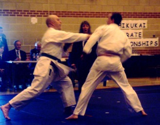 2008 - Shikukai National Championships, John Ebel (L) scores on his opponent with gyakuzuki.