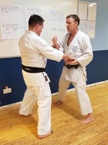 Tim Shaw explaining aspects of Ohyo Henka Dosa. With Steve Thain Sensei.