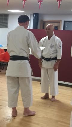 Tim Shaw is presented with his 7th Dan certificate from Sugasawa Sensei.