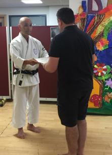 Steve Thain presented with his 4th Dan certificate.