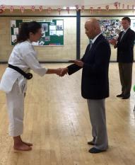 Natalie Hodgson receives her trophy for the senior kata title at the shikukai National Championships.
