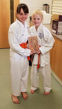 Two junior members of Shikukai Chelmsford celebrating their grading success.