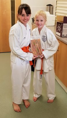 Two junior members of Shikukai Chelmsford celebrating their grading success.