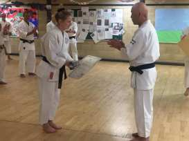 Teresa Claxton being presented with her new obi and certificate for shodan by Sugasawa Sensei.